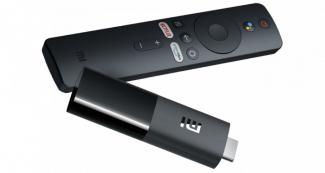 Купить выгодно Xiaomi Mi TV, зарядка Stick KUULAA Qi и наушники 1MORE